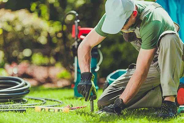 man-installing-sprinkler-system-fort-collins