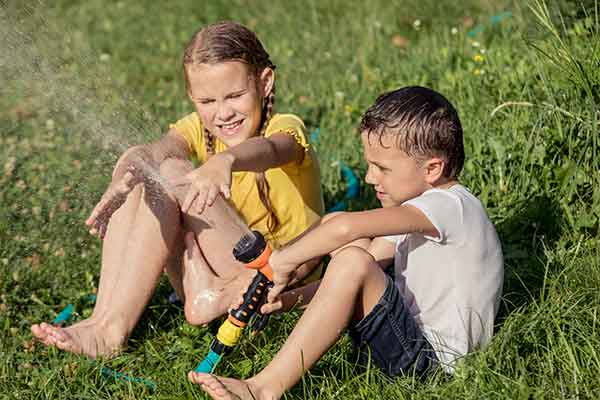 kids-watering-lawn-fort-collins-co